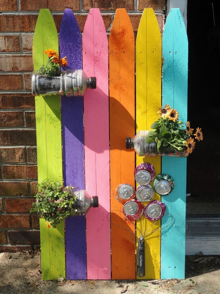 This is a project I made for a garden recycle art contest...made from old fencing, powerade bottles, cans & kitchen wisk ;)