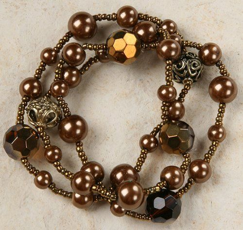 Bracelet Set - 3 Strands, Bronze Tones - Stretchy Curious Designs. $12.99. Please see our apparel, mosaic ceramic and bead lines!. 3 separate bracelets!. Free shipping on orders over $75.00.. Fun bronze tone beads.. More 3 piece bracelet sets.. Save 19%!