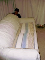 Happy Hearts At Home: Frugal Couch Makeover: Easy Slip Cover....Genius! doing this!