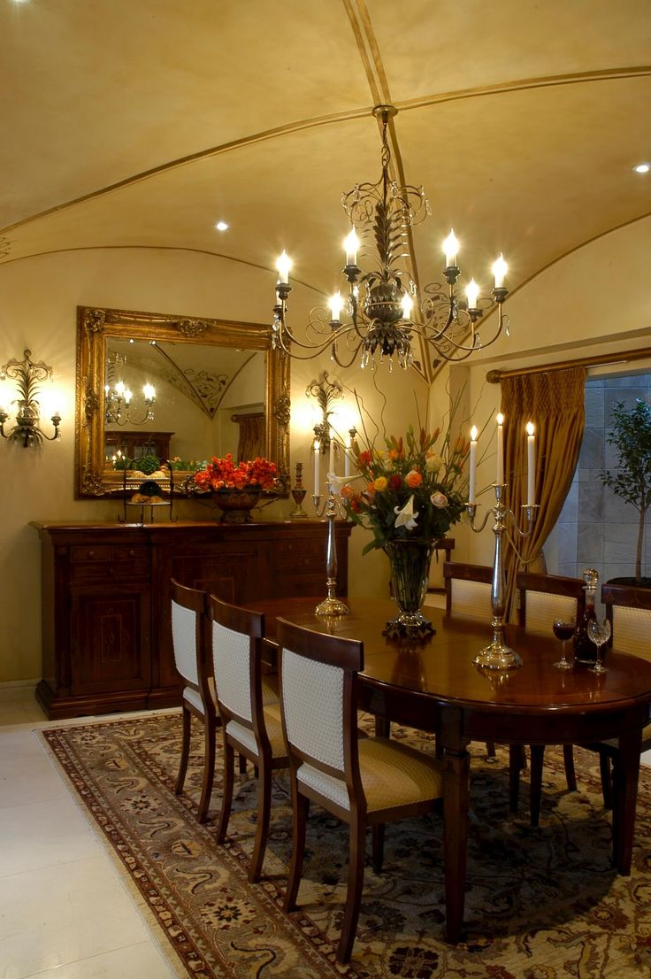 A contemporary home in Johannesburg, inspired by Classical Italian interior design and decoration. Sumptuous use of rich fabrics. Creative paint techniques. Impressive chandeliers. Dining room with beautiful classical inspired furniture.