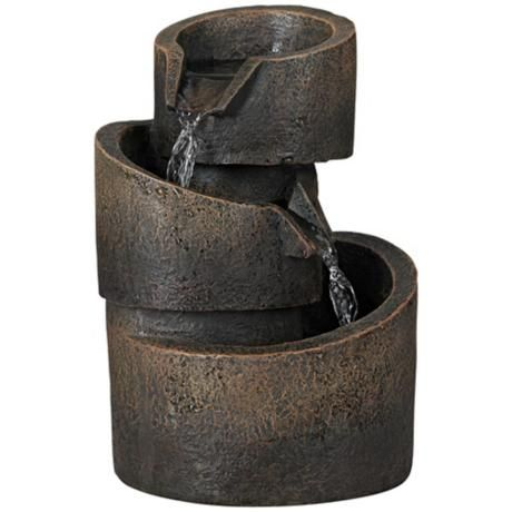 http://diy-gardensupplies.com/ 3-Tier Bronze Stone Contemporary Tabletop Fountain  With a stone look but durable polyresin construction, this tabletop fountain has a neutral color to better complement your indoor decor. An electric pump routes water through the spout, and the water trickles down each level creating soothing water sounds.