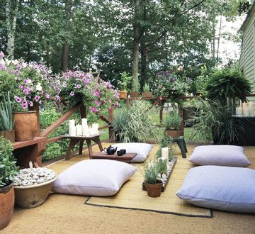 Zen Hideaway:  Create your own Japanese tearoom on a deck or balcony. A woven-grass rug defines the space, while large floor pillows and a bamboo mat welcome visitors. Candles, river rocks, and the scent of rosemary provide Eastern ambience.