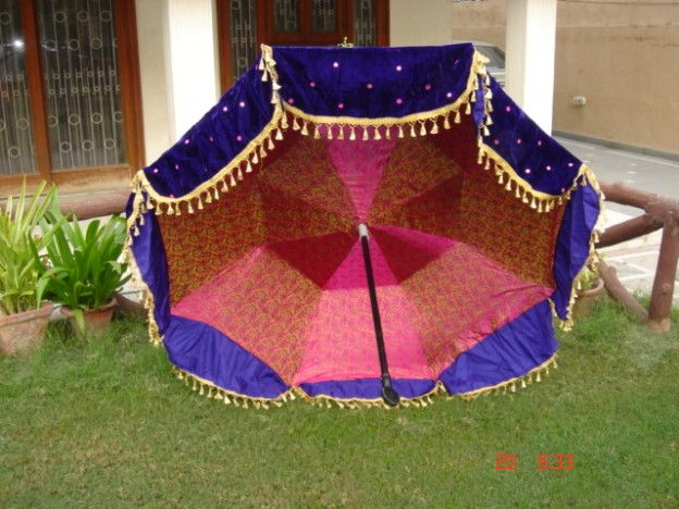 Designer umbrellas for weddings with brocade interiors