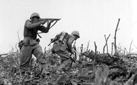 A U.S. Marine on Okinawa fires his Thompson submachine gun. (Image source: Wikimedia Commons)