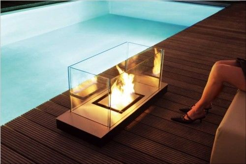 Inspiring Modern Outdoor Fireplaces – The Best Outdoor Decorations : Modern Outdoor Fireplaces With Square Glass Fireplace Design And Outdoor Pool And Hardwood Floor With White Sofa