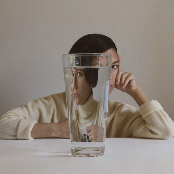 Super fascinating portrait, shot through a glass of water.