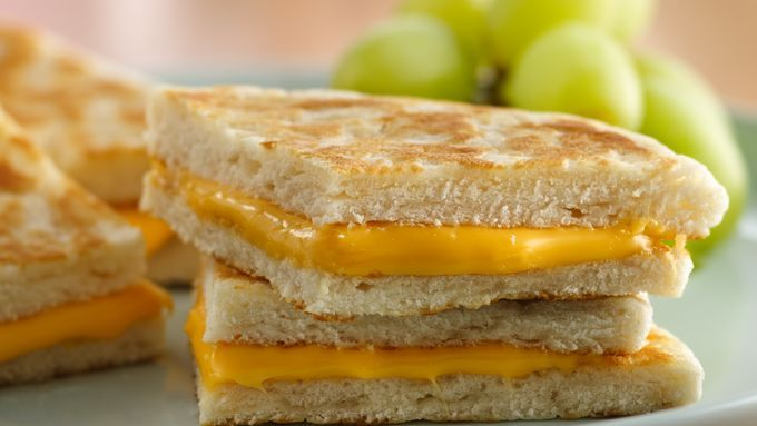 Biscuits do bread one better and make a grand grilled cheese sandwich!