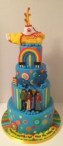 The Beatles are classic - especially this Beatles cake that celebrates their awesome album Yellow Submarine.  The Yellow Sub on top is made from Rice Krispie Treats.