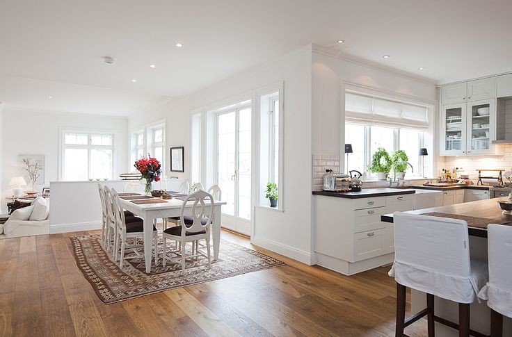 White kitchen, white dining room and do I see a white family room back there? This is a great space.