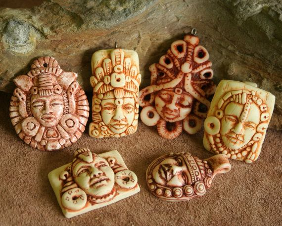 hand sculpted Polymer Clay tribal Face pendants by FaceARTifacts