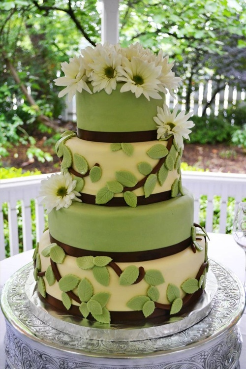 brown and white wedding cake leafy green four tier fondant wedding cake lined with 12189