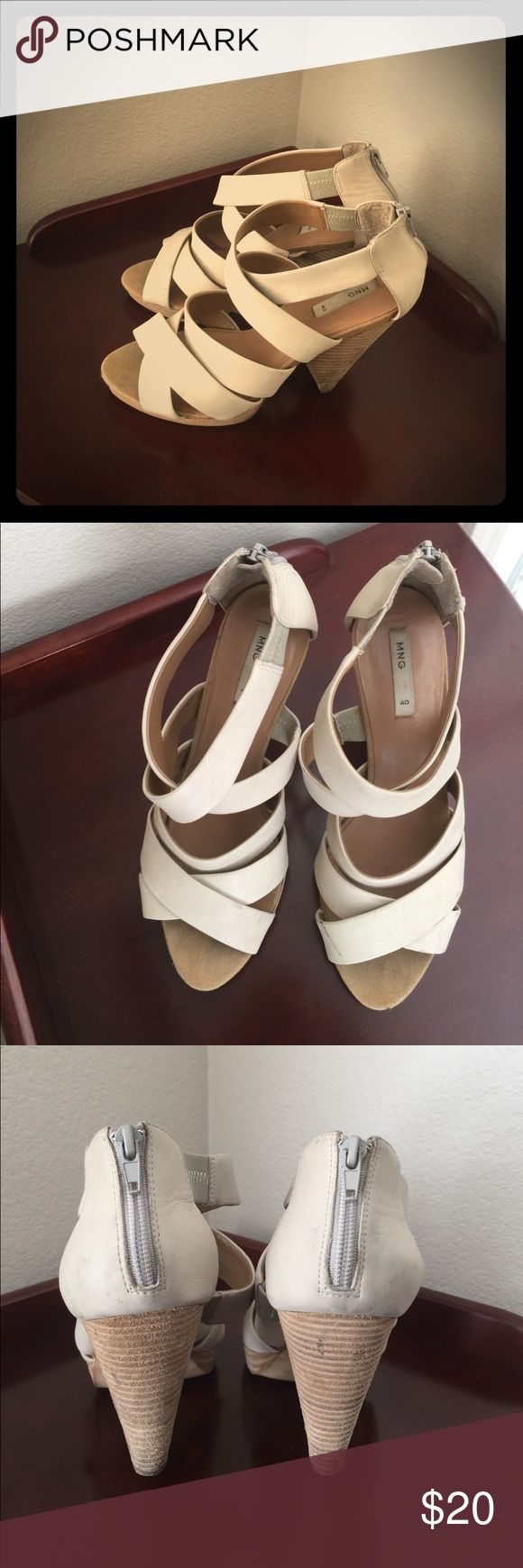 Mango beige heels Comfortable and stylish shoes that can be dressed up or down. MNG size 40(Eu)/ size 10 (US) heels. Off white straps. Can dress up or down with them. Bought at Mango store. Zipper at back of each foot. Worn and do have a few marks/ scratches/ please see pictures and ask questions! Happy to answer any questions you may have. Mango Shoes Heels