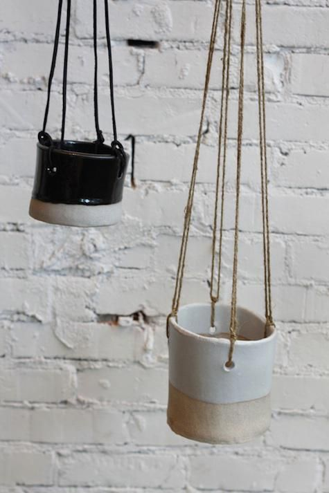 rustic hanging pots by TW Pottery. The handmade pots feature a mix of glazed and rough finishes and come complete with cords for hanging; prices range from $50 to $60.