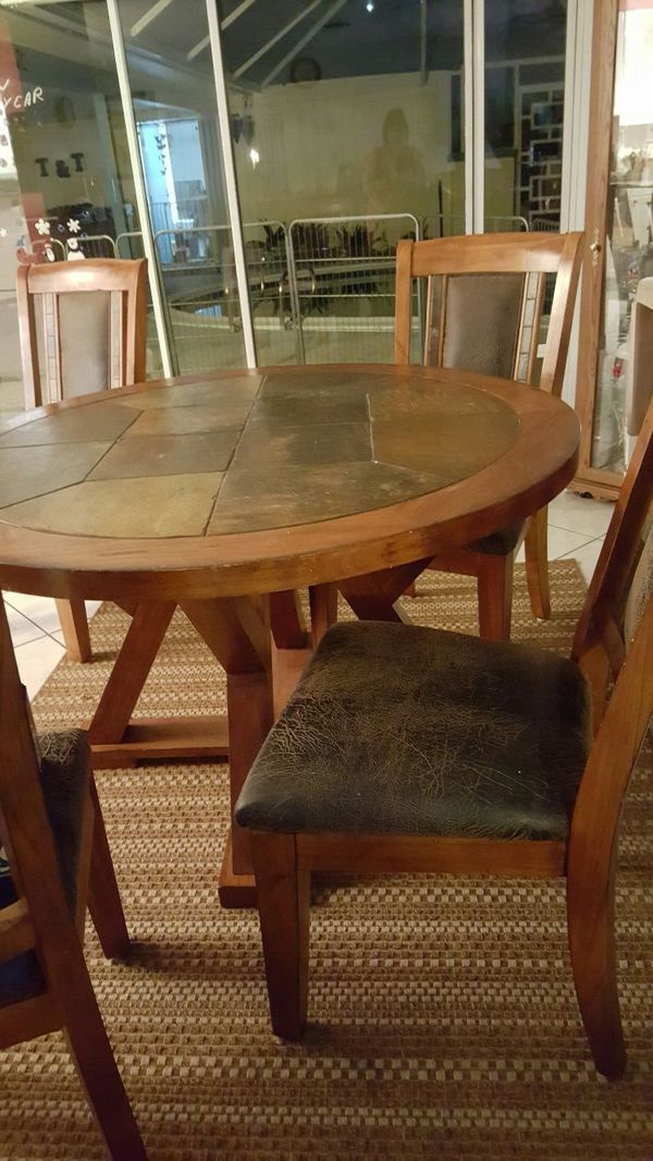 Used (normal wear) Solid wood dining table with 4 chairs