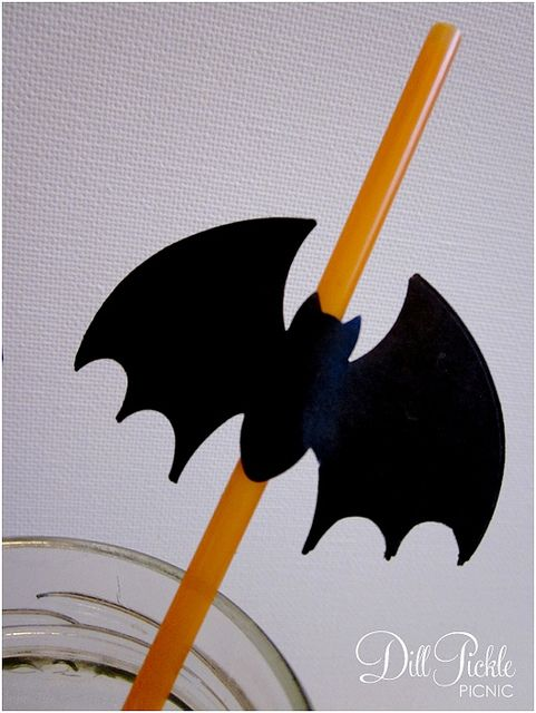 Make bat food picks or straws using bat hole punch. Glue two back to back.