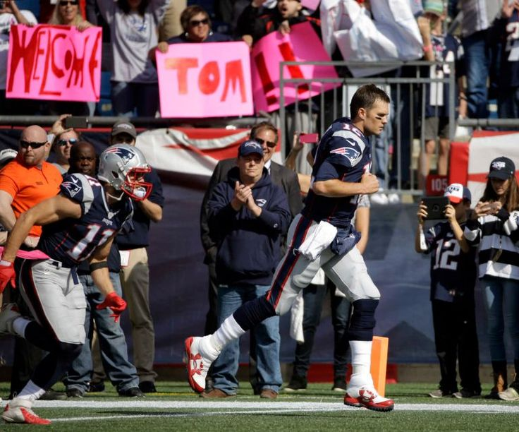 Bengals vs. Patriots:     October 16, 2016  -  35-17, Patriots  -     New England Patriots quarterback Tom Brady runs past welcoming signs as he takes the field for an NFL football game against the Cincinnati Bengals, Sunday, Oct. 16, 2016, in Foxborough, Mass.