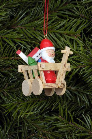 A tiny Santa driving his little wagon - Tree decoration