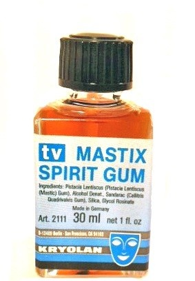 Strong but gentle cosmetic adhesive such as eyelash glue or Spirit gum - an adhesive for special effects makeup, wigs and prosthetics. Example: Mastix Spirit Gum $9.99