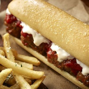 Here's the meatball sandwich in real life (left), compared with Olive Garden's promotional photo (right): | We Tried Olive Garden's New Breadstick Sandwich And Here's What We Learned