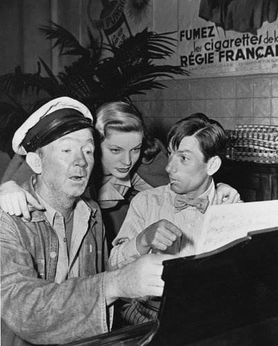 """Lauren Bacall with Walter Brennan and Hoagy Carmichael on the set of """"To Have and Have Not"""""""