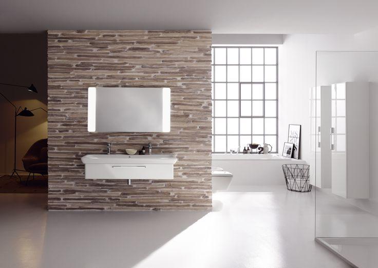 Deze badkamer matcht modern met cottage style en ademt pure ontspanning. De unieke combinatie van sobere kleuren, ruwe materialen en optimale lichtinval creëren een unieke mix van strak en rustiek.