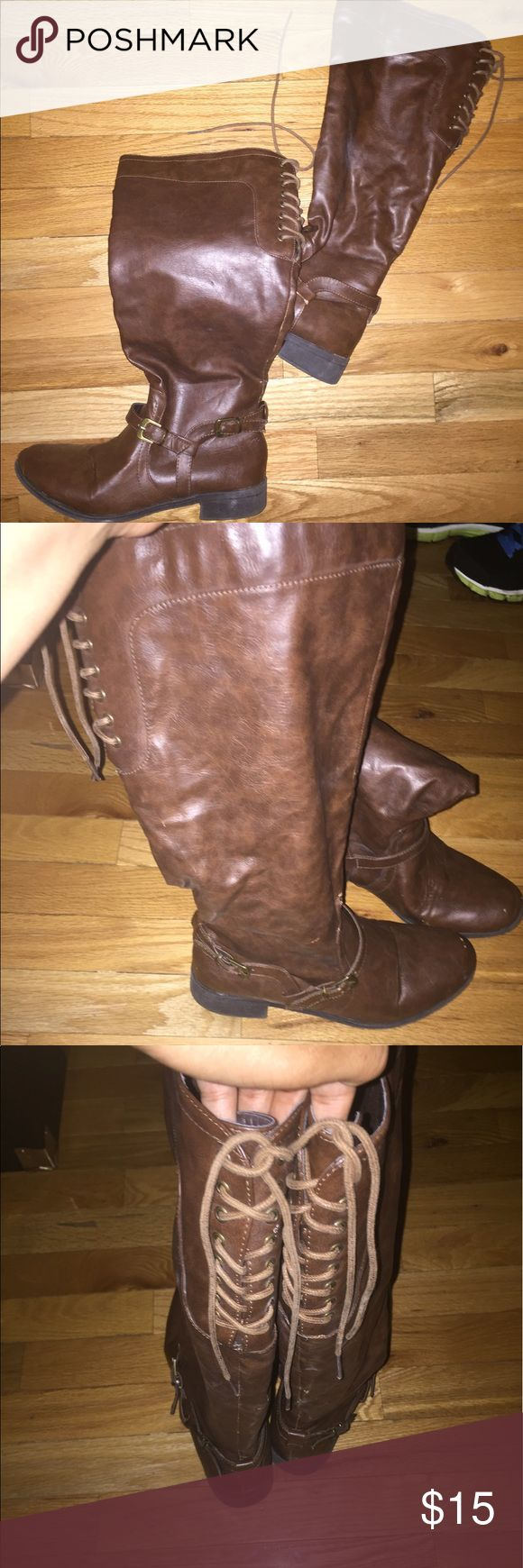 Wide Calf Boots Brown wide calf boots that lace up in the back. They are comfortable and cute. They have some wear. Shoes Winter & Rain Boots