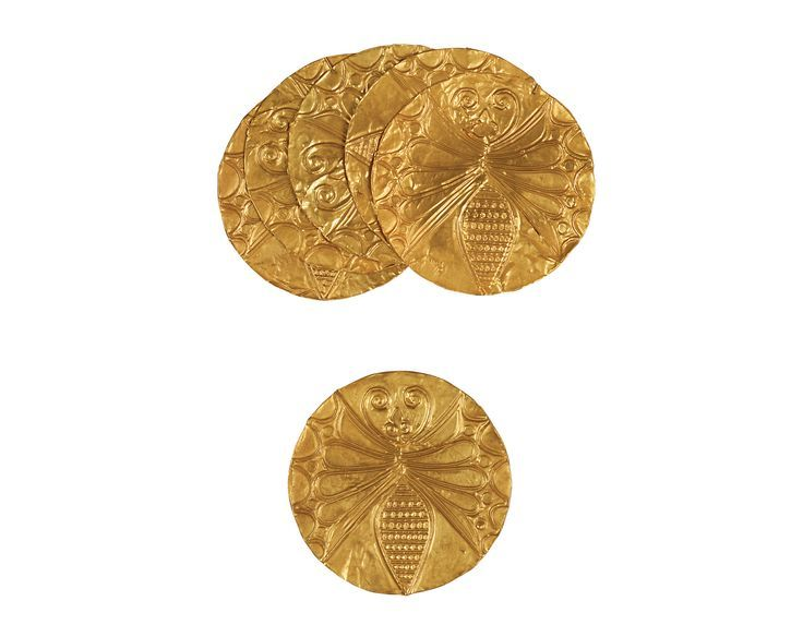 Gold Mycenean roundels with repoussé motifs: butterfly, octopus, leaf, rosette, spirals