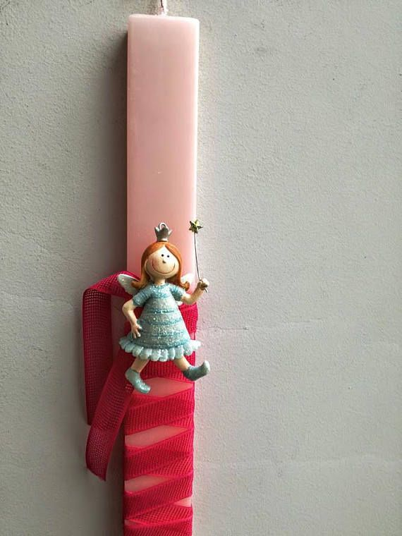 Fairy Easter candle fairy girl ornament on pink Greek Easter