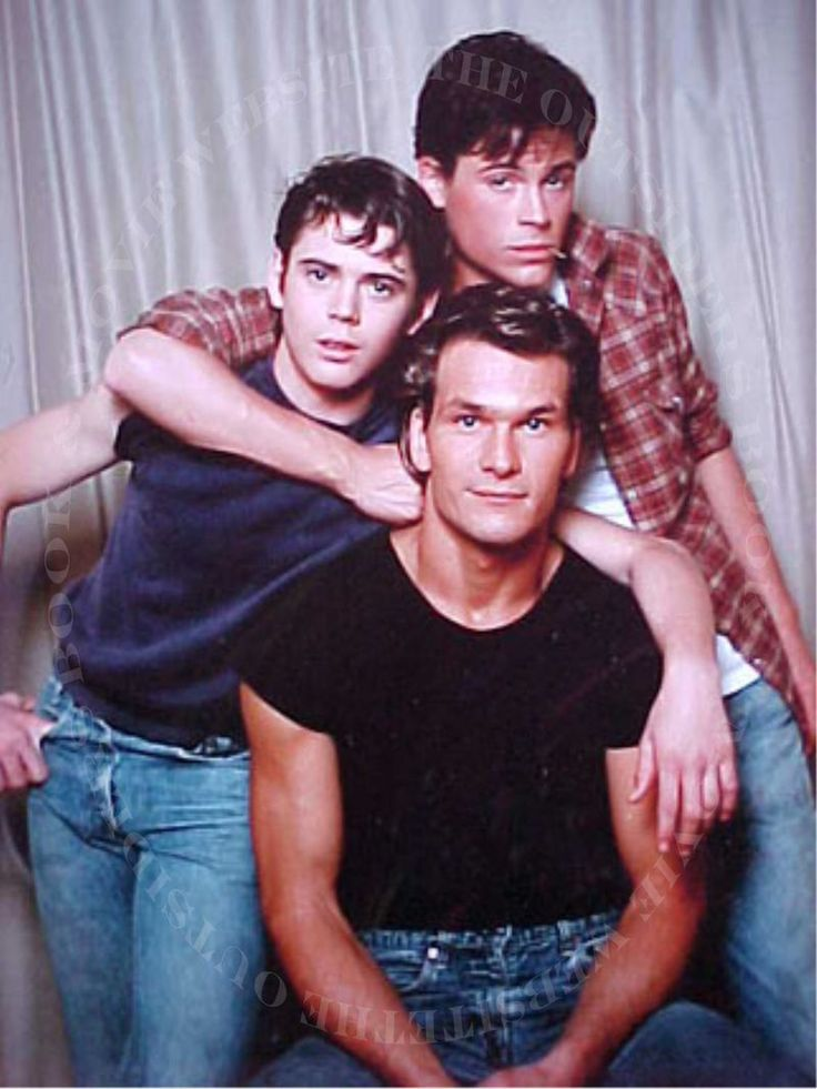Patrick Swayze with C. Thomas Howell and Rob Lowe, as the Curtis Brothers in Francis Ford Coppola's The Outsiders (1983).