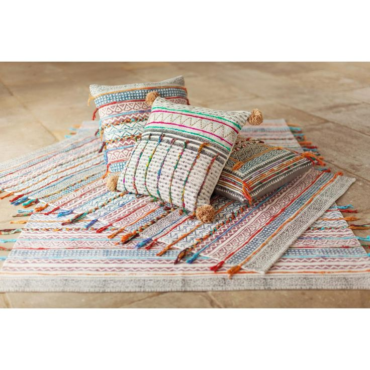 Our striped global fusion rug brings colours, patterns & textures in pure cotton. Traditional techniques such as loom weaving, hand block printing, stonewashing finished with tassel & pompom trims.