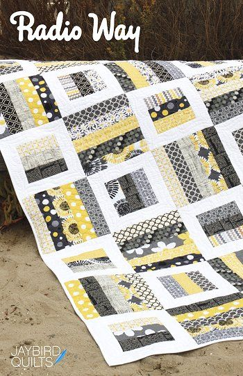 Radio Way quilt pattern.  Squares made of strips.  Color combo is excellent - gray, black, yellow, white.