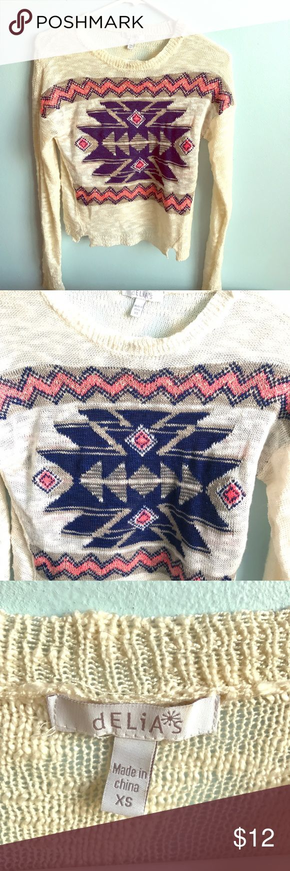 Tribal print sweater Super cute sweater. It is see thru. There is navy, coral, and white on the cream sweater. Only wore it once. It looks great in the spring and summer being so lightweight American Eagle Outfitters Sweaters Crew & Scoop Necks