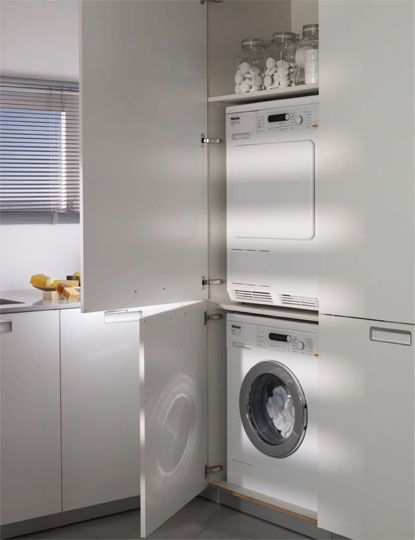 SANTOS kitchen | Solutions for the laundry    Tall unit containing the washing machine and dryer. One of the cupboards contains the washing machine and the dryer and also has room for the washing powder and fabric softener.