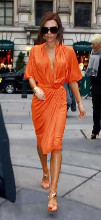 Victoria Beckham I'm orange.  Love this color on a tan body