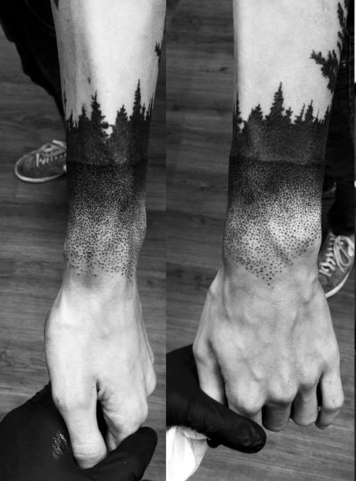 harmonious tree and forest tattoo on arm. pictorial feeling design.