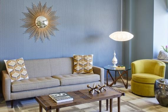 Decorative lighting, residential style furniture, and decorative elements are on display at One Medical Group's Burlingame, Calif., primary ...