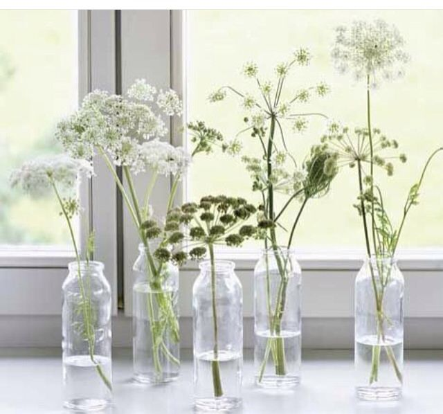 Little vases and wildflower as