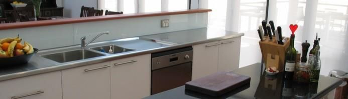 Granite and stainless still benchtops feature in this kitchen