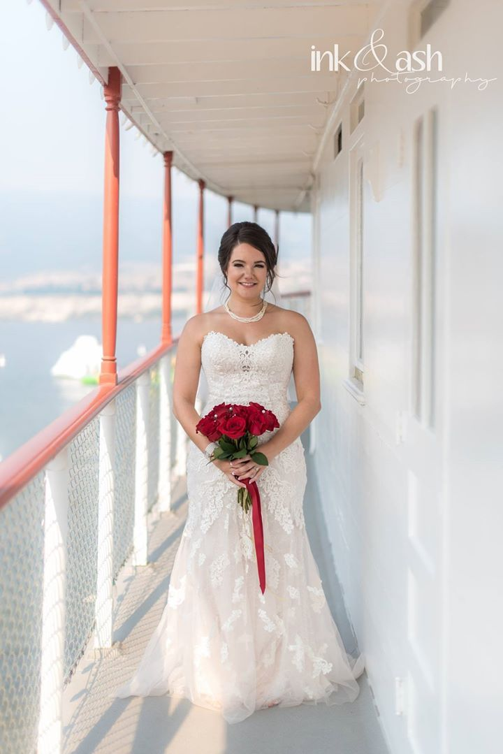 Bride out on the deck of the Sicamous. Photo by Ink and Ash Photography