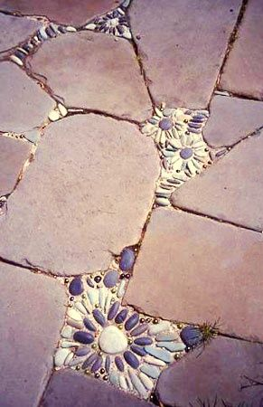 paving stones with pebbles to fix cracked tiles or mosaic it!                                                                                                                                                      More