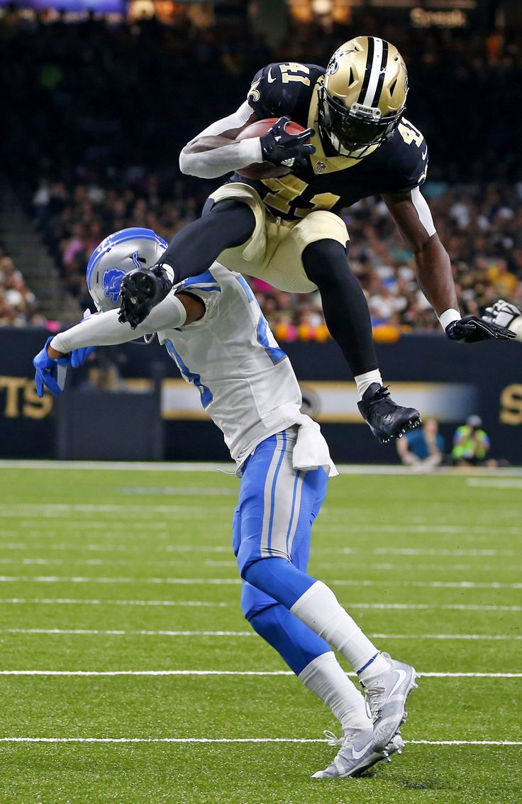 Alvin Kamara going UP for his Saints in Week 6, leaping over Detroit Lions cornerback Darius Slay to earn some extra yards (AP/Dill).