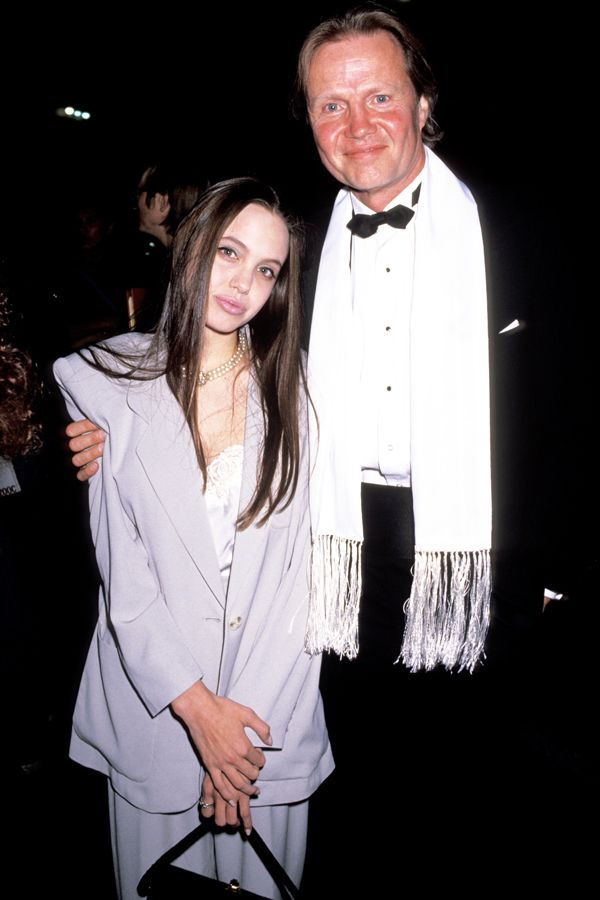 """18 Brutal Pics Of  Celebrity Teen Angst #refinery29  http://www.refinery29.com/2014/08/73603/90s-fashion-red-carpet-photos#slide13  """"Dad, are we done yet?"""" wonders Angelina Jolie."""