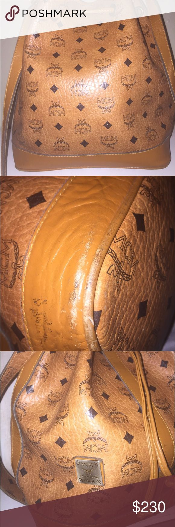 Vintage mcm bucket bag Purchase at a thrift store years ago so I'm not sure about authenticty. No tags inside,stained with pen ink so will be selling it for a decent price. Send reasonable offers MCM Bags Shoulder Bags
