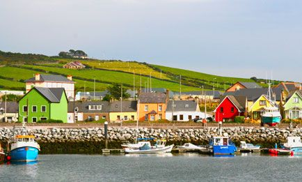 """""""The town of Dingle is the classic Irish fishing village. Fresh fish & chips at every pub makes this unique town a must for everyone. Coming out from a nice lunch from Murphy's pub offers this great view of the Bay...the colors are mindblowing""""  Photo by herbienj"""