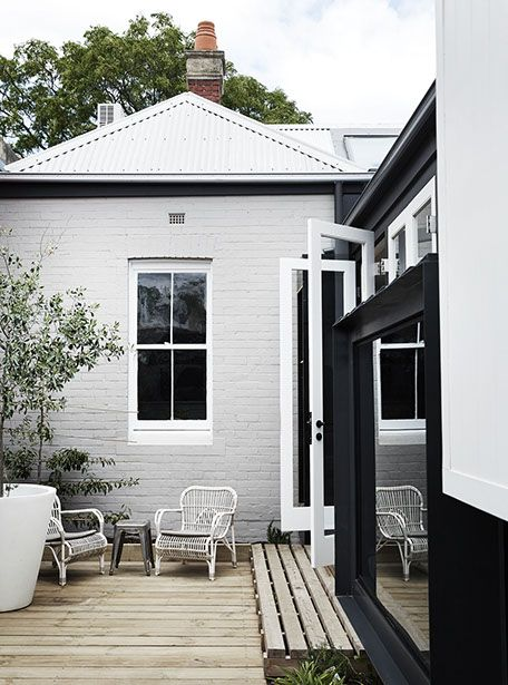 Whiting Architects - OGrady - brick, white trim, black steel, oak colour boards