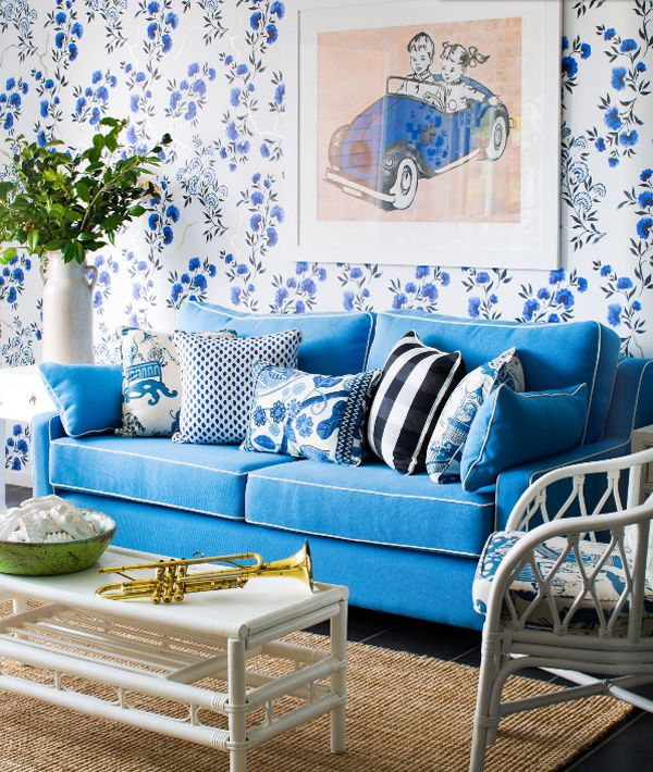 Blue sofa with white piping