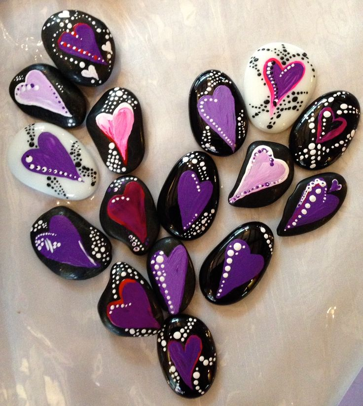 Hand-painted pebbles, as table décor and party favors