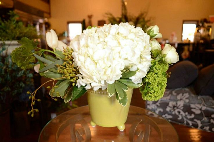Small green footed vase, White hydrangea, viburnum, seeded eucalyptus, white tulips