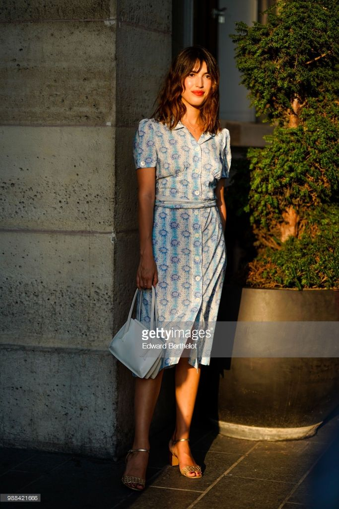 60c7e24175 Jeanne Damas wears a blue dress with floral...