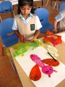 Eric Carle collage. Kids paint tissue paper with rollers, then cut wings and body using templates. From Art Lessons For Kids